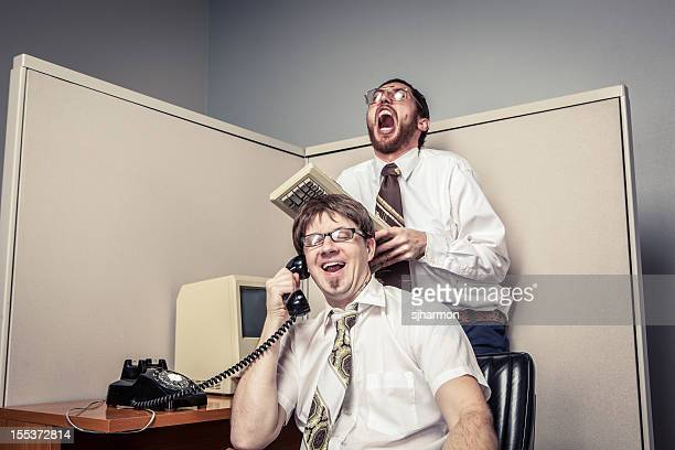 Two Comical Nerdy Office Workers, on Phone and Laughing