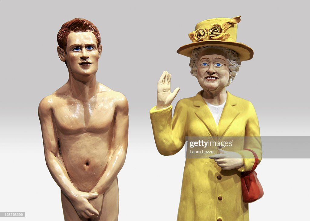 Two commemorative figurine created by artisan Genny Di Virgilio depicting (L to R) <a gi-track='captionPersonalityLinkClicked' href=/galleries/search?phrase=Prince+Harry&family=editorial&specificpeople=178173 ng-click='$event.stopPropagation()'>Prince Harry</a> and Queen Elisabeth II are displayed at San Gregorio Armeno on March 14, 2013 in Naples, Italy.