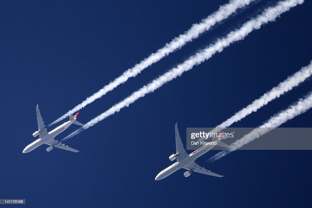 Two commercial airliners appear to fly close together as the pass over London on March 12 2012 in London England