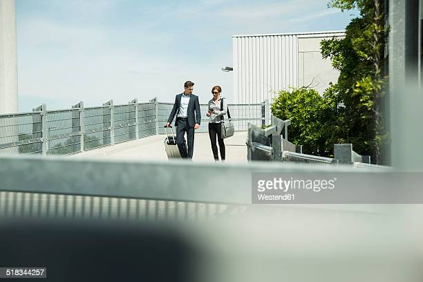 Two communicating business people on business trip