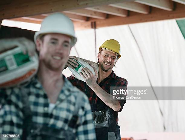 Two Construction workers on Building site