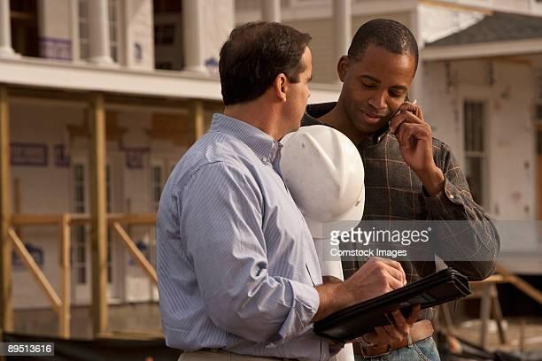 Two Contractors looking over plan details