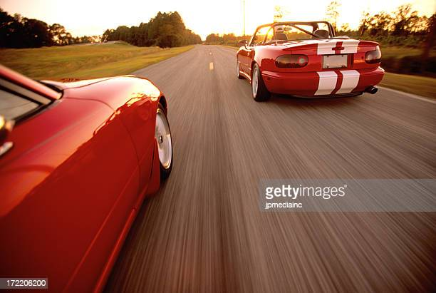 two convertables with motion