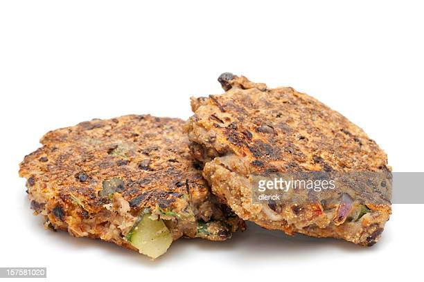 two cooked vegetarian black bean hamburger patties