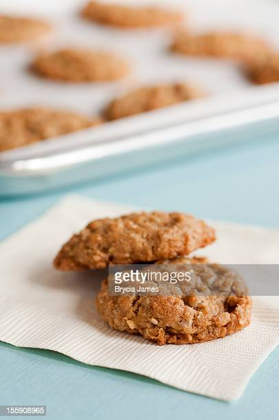 Two Cookies on a Napkin with Cookie Tray in Background