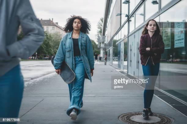 two cool teenage girls walking in Berlin