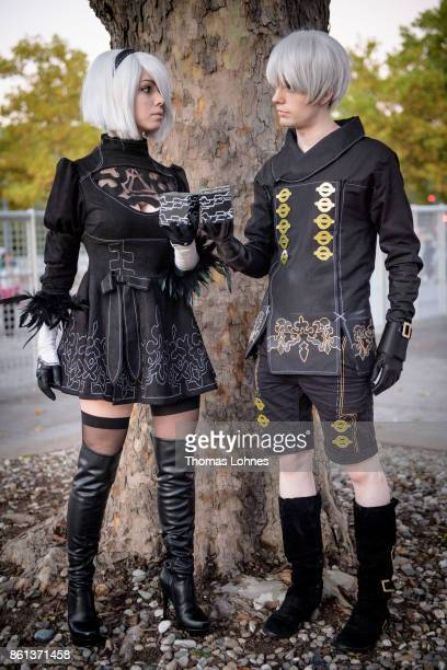 Two cosplayer pose as '2B' and '9S' of the game 'Nier' at the 2017 Frankfurt Book Fair on October 14 2017 in Frankfurt am Main Germany The 11th...