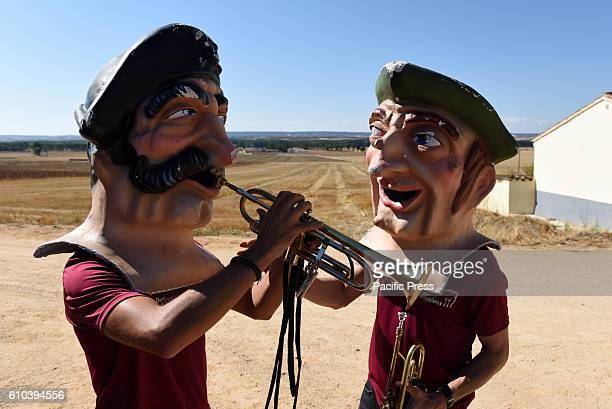 Two costumed figure 'Cabezudos' pictured during the 'La Virgen de la Carrera'' festival in 'Mature de Almazán' north of Spain