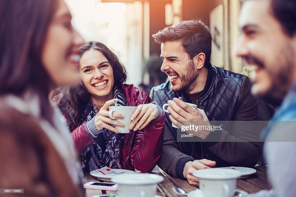Two couples drinking tea and coffee : Stock Photo