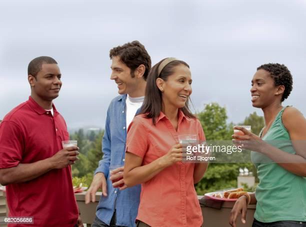 Two couples enjoying backyard party