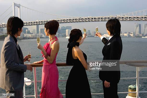Two couples enjoying the view onboard a cruise ship