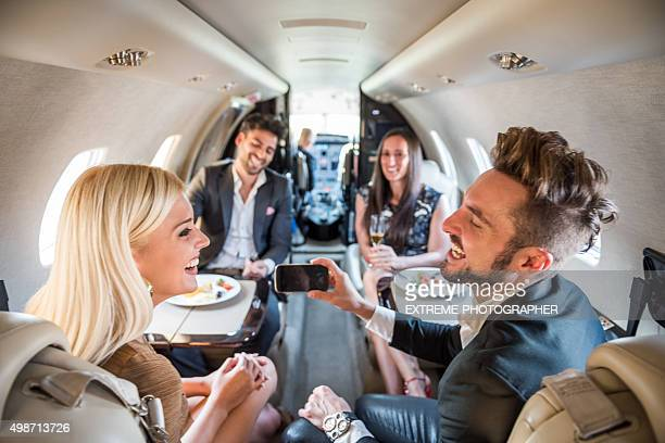 Two couples having a meal in private jet airplane