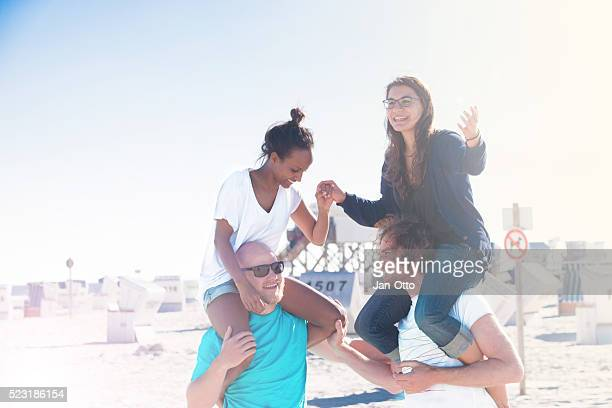 Two couples having fun at the beach of St.Peter-Ording,Germany.