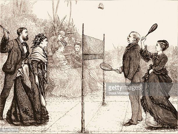 Two couples in Europeanstyle clothes play a game of badminton India 1874