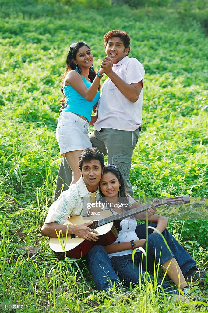 Two couples on a picnic : Stock Photo