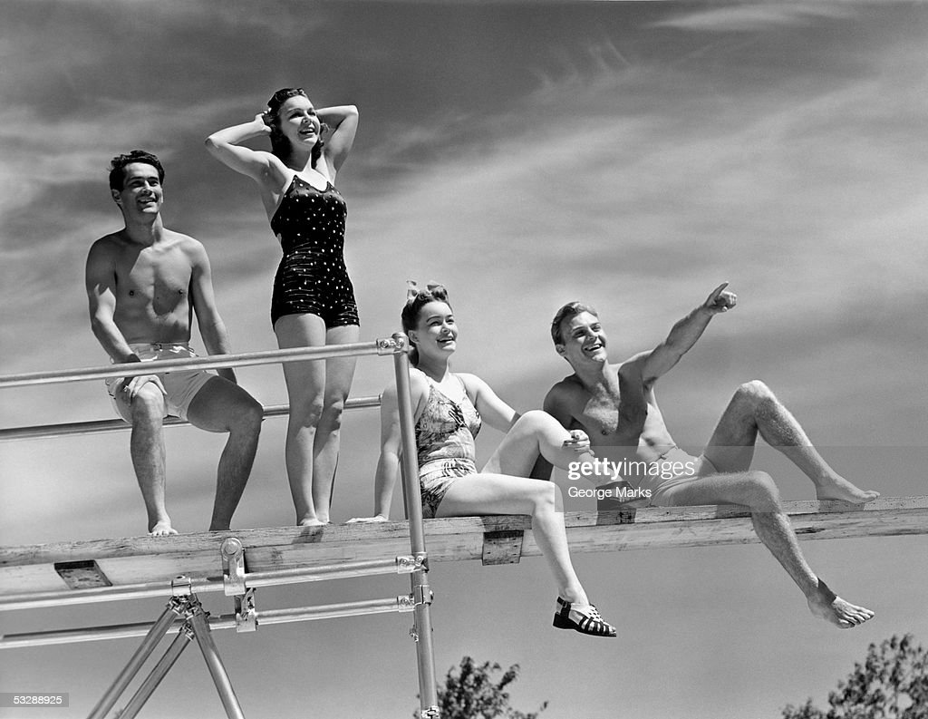 Two couples on diving board : Stock Photo