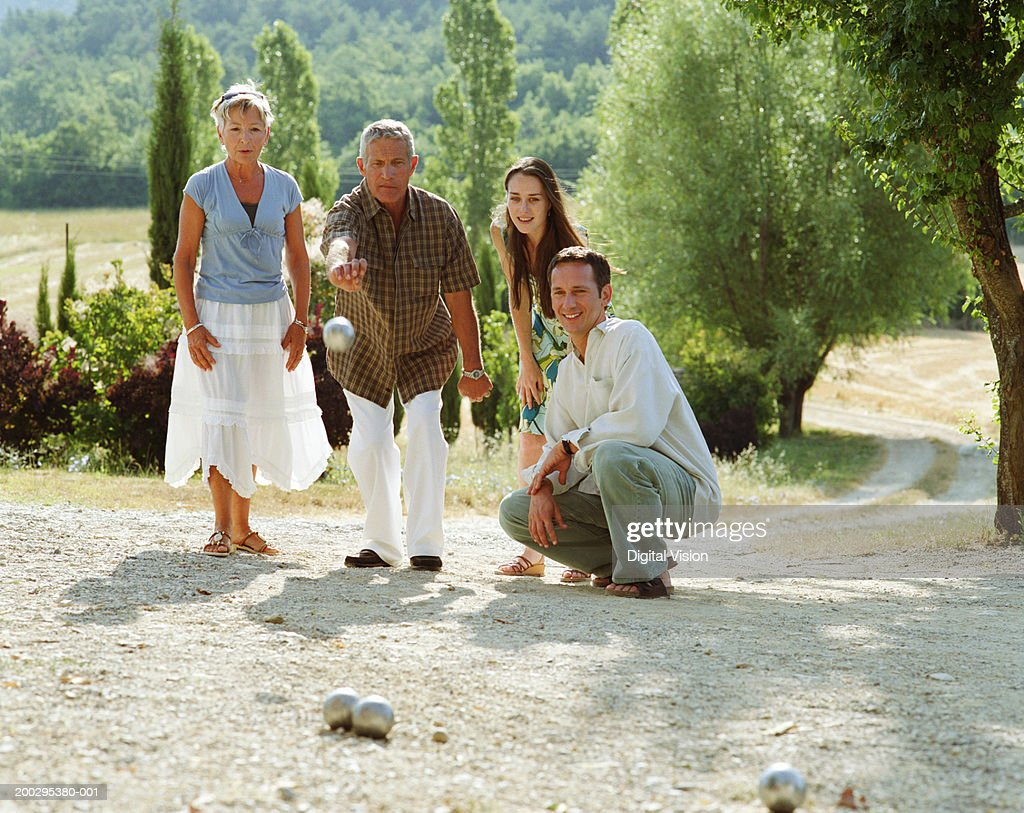 Two couples playing boule : Stock Photo