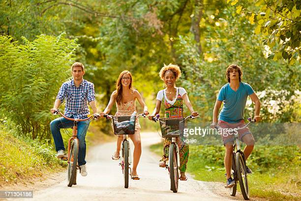 Two Couples Riding Bicycles in a park
