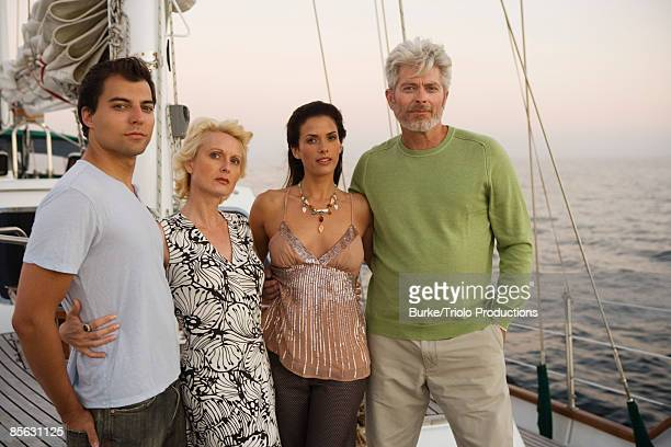 Two couples standing together on boat