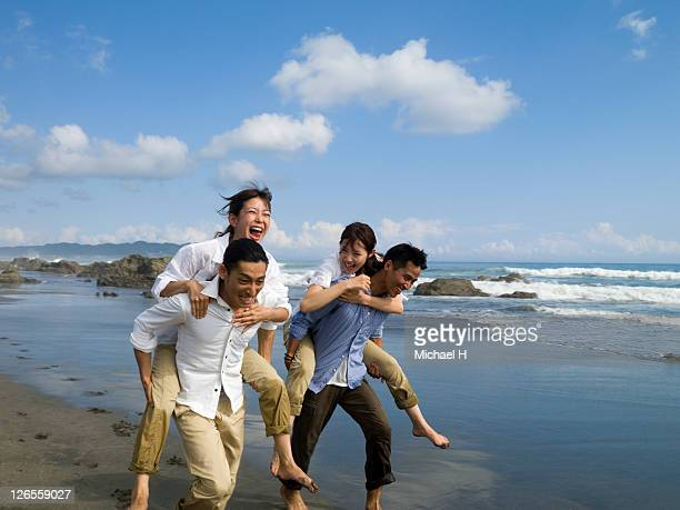 Two couples who compete happily on a beach