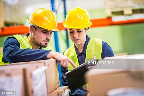 Two Coworkers Checking Supplies in the Warehouse