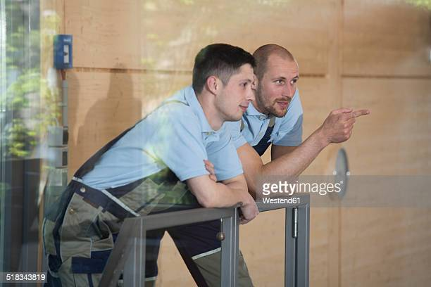 Two craftsmen talking