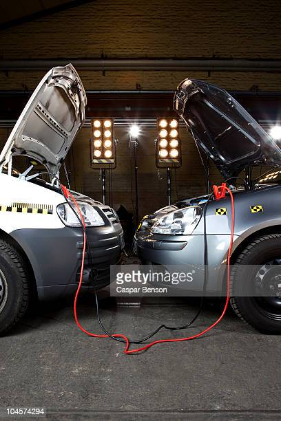 Two crash test cars with jumper cables