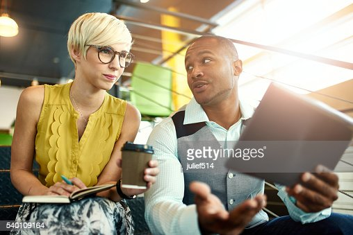 Two creative millenial small business owners working on social media : Stock Photo