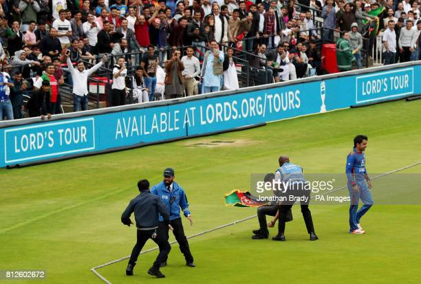 Two cricket fans invade the pitch near to where Rashid Khan is fielding during the one day match between MCC and Afghanistan at Lord's London