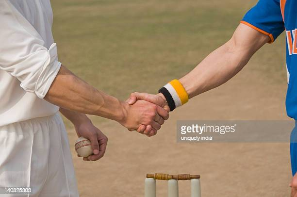Two cricket players shaking hands