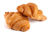 two croissant isolated on white background closeup.