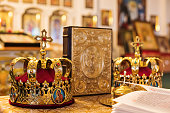 Two crowns next to the bible for a wedding ceremony, close-up.