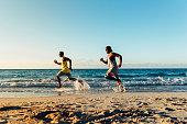 Two cuban friends having fun in the beach. Friendship concept.