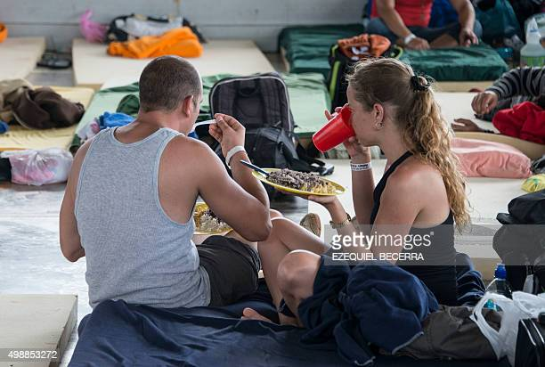 Two Cubans eat in a shelter in La Cruz Guanacaste Costa Rica near the border with Nicaragua on November 26 2015 Latin American ministers failed in...
