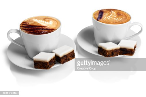 Two cups of cappuccino coffee with wedding cake : Stock Photo