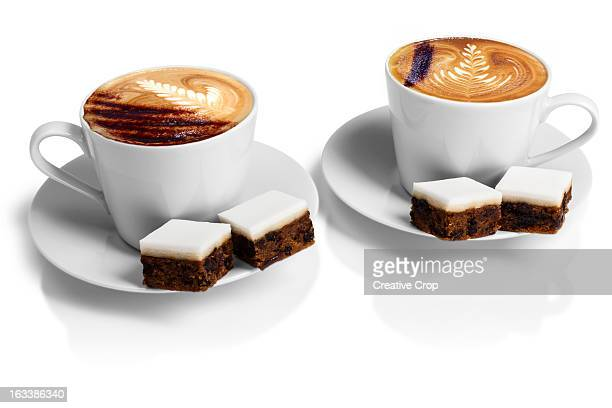 Two cups of cappuccino coffee with wedding cake
