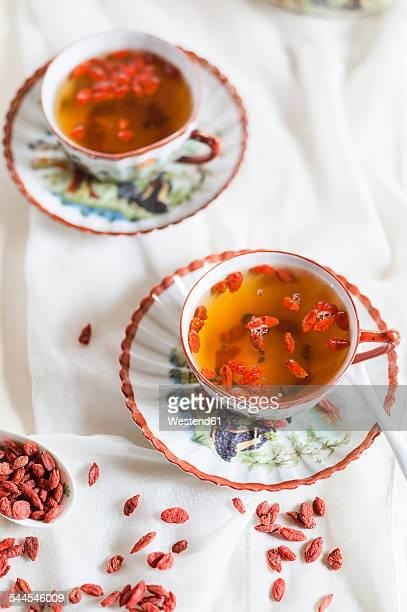 Two cups of green jasmine tea with dried Goji berries, Lycium barbarum