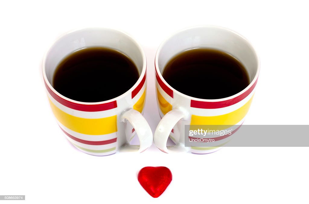 Two cups of tea and heart on a white background. : Stock Photo