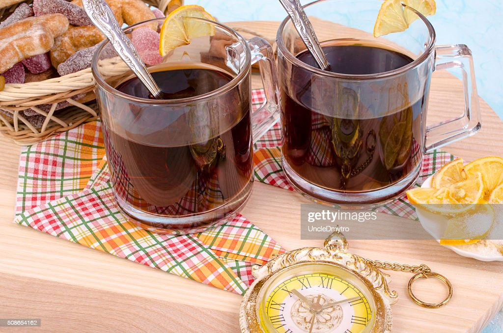 Two cups of tea, lemon, basket with cookies. : Stock Photo