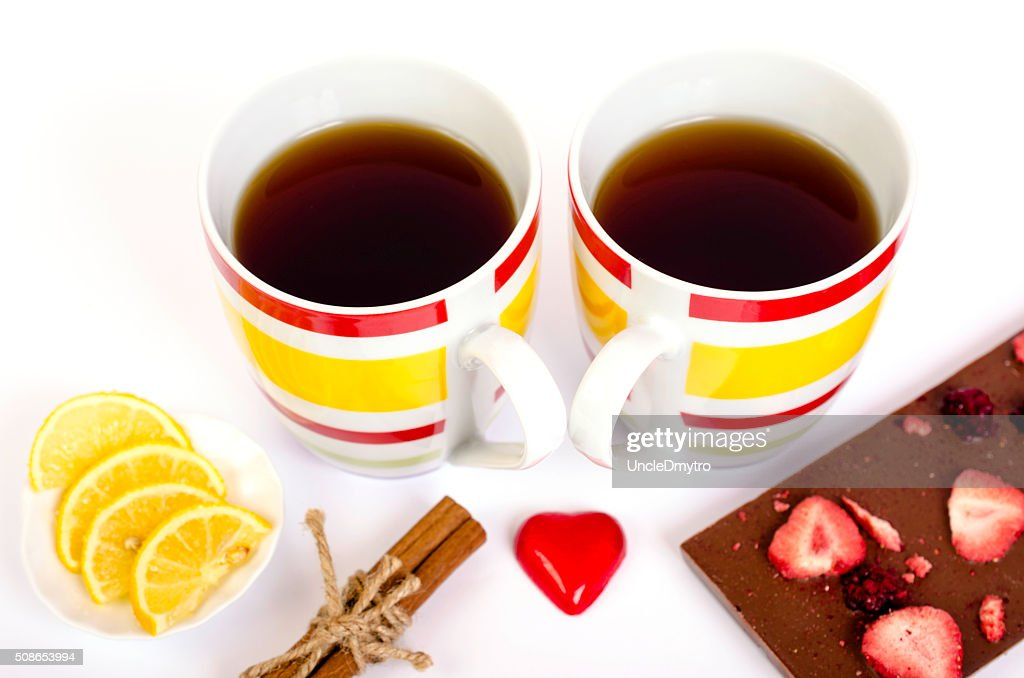 Two cups  tea, chocolate, lemon and cinnamon on white backgrou : Stock Photo