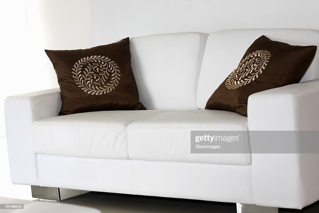 Two cushions on a couch : Stock Photo