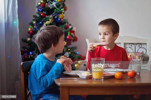 Two cute boys, having breakfast
