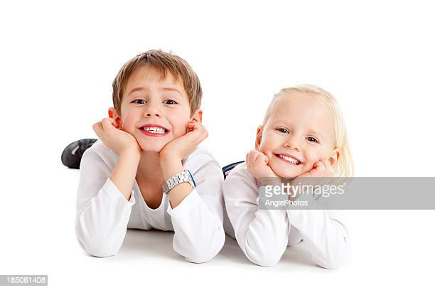 Two cute children grin
