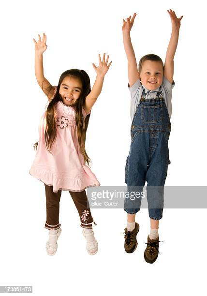 Two cute kids jumping