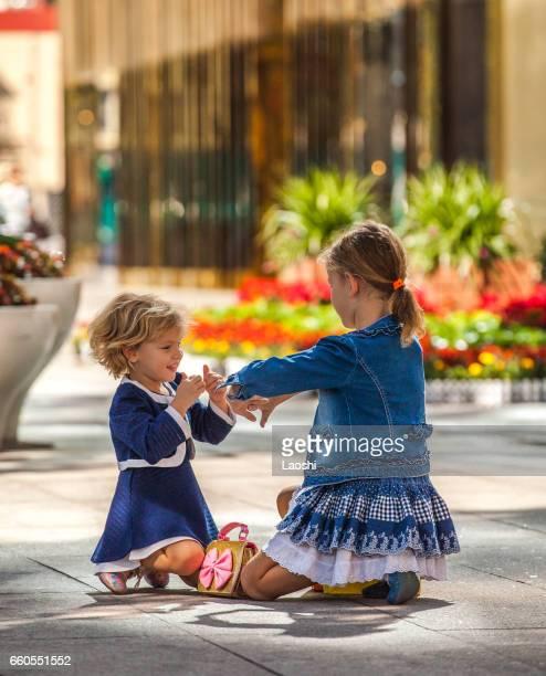 Two cute little girls in city