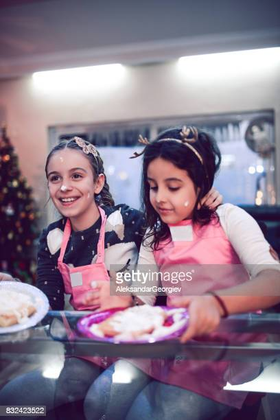 Two Cute Sisters Eating Their Cake after Baking Class