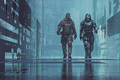 Two cyborg soldiers walking in futuristic city.