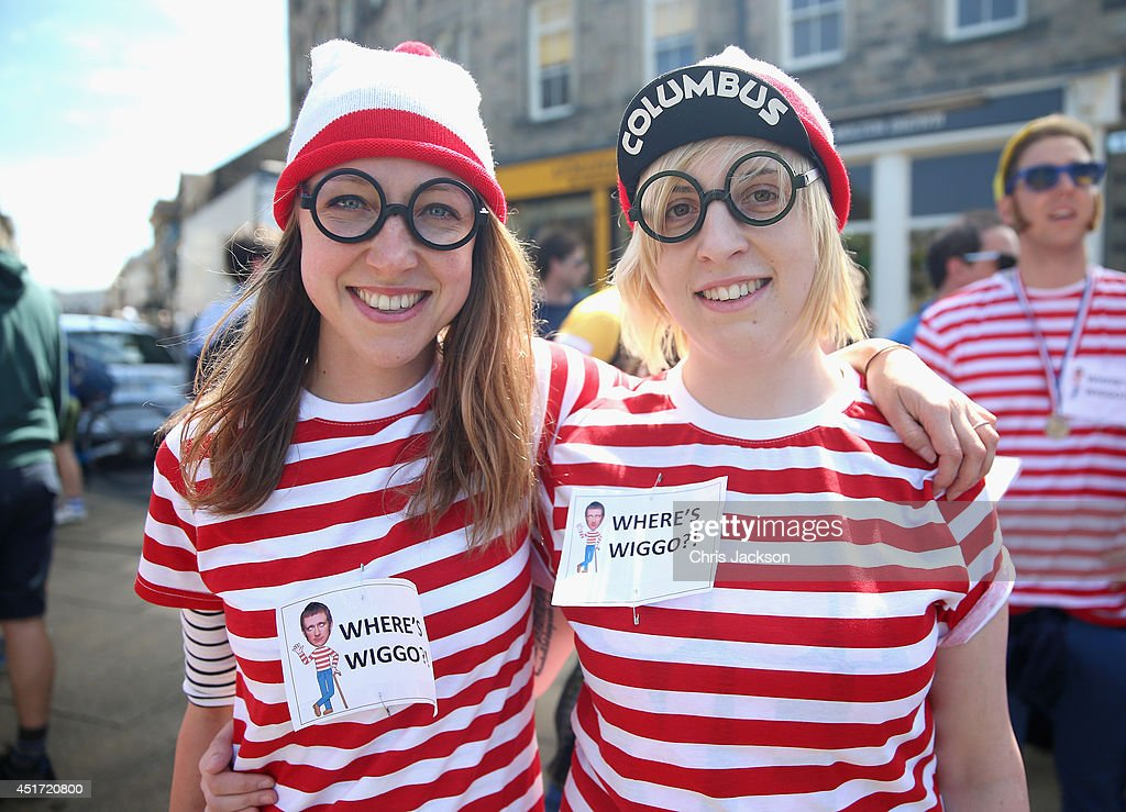 Two cycling fans wear 'Where's Wiggo' t-shirts in reference to British cyclist Bradley Wiggins on July 5, 2014 in Harrogate, United Kingdom. Spectators and residents prepare themselves and gather on the streets as they get ready to watch Stage 1 of the Tour de France.The world's greatest cycle race, the Tour de France starts for the first time in its history in Yorkshire this weekend . The event is expected to bring thousands of cycling fans to the region