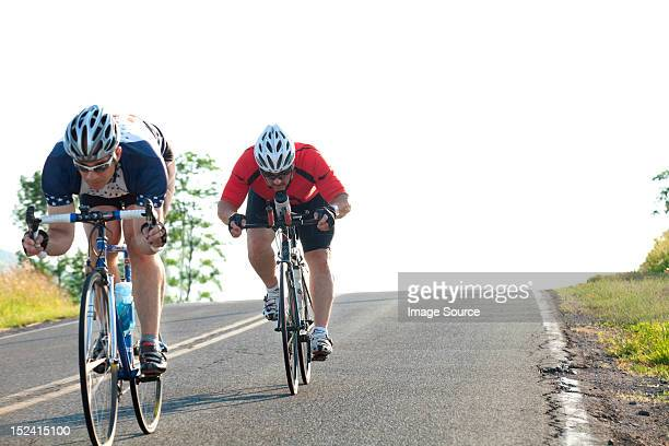 Two cyclists or road, racing downhill