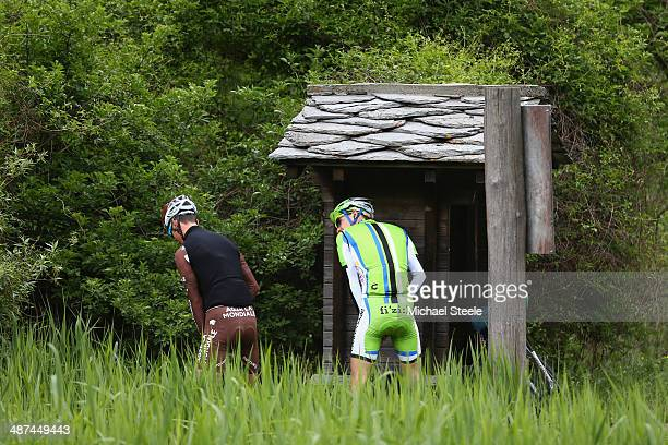 Two cyclists take a conventional toilet break ahead of the shortened stage start at Brigerbad during stage one of the Tour de Romandie from Ascona to...